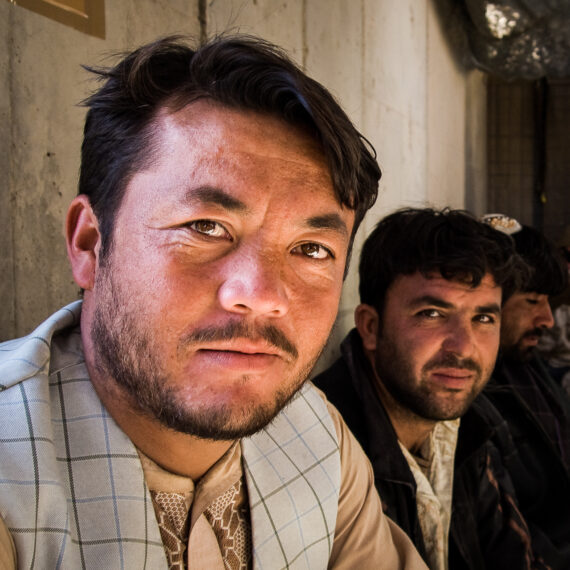 Military photography: Afghan civilians wait to be processed at the Main Entry Point to Camp Bastion, Afghanistan.