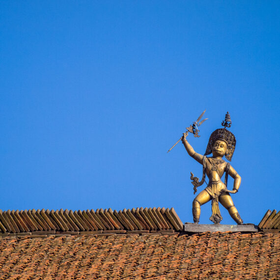 Nepal travel photography: A statue of the Hindu deity Hanuman atop the Hanuman Dhoka, an old royal palace in Durbar Square, Patan, near Kathmandu, Nepal
