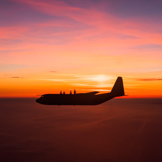 Military photography: A Royal Air Force C-130J Hercules transport aircraft is seen from an RAF Voyager aircraft preparing for air-to-air refuelling over the North Sea at sunset on 6 April 2017.