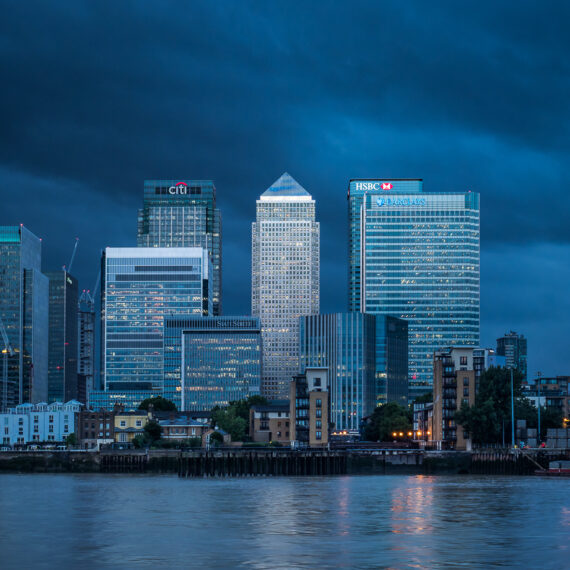 Travel photography England: Canary Wharf, a major financial district in London, is seen at night from across the River Thames.
