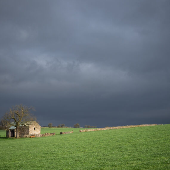 Travel photography England: A barn on the Pennine Way long-distance footpath is pictured under dark rain clouds in North Yorkshire, UK, on 16 April 2018.