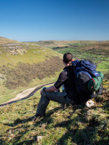 A man overlooks the River Swale from North Gang Scar, a hill feature near the village of Keld on the Pennine Way long-distance footpath in North Yorkshire, UK, on 19 April 2018.