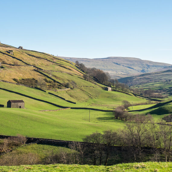 Travel photography England: Yorkshire dales farmland seen from the Pennine Way long-distance footpath near Keld in North Yorkshire, UK, on 19 April 2018.
