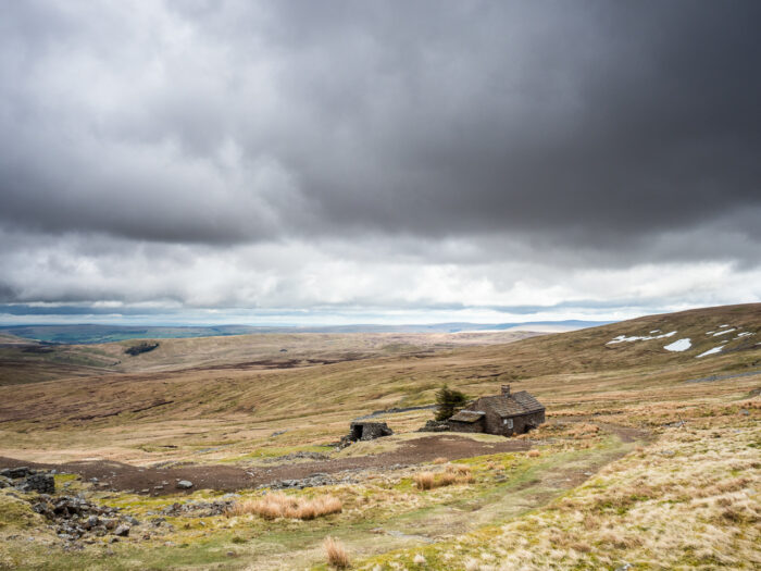 Adventure travel photography: Greg's Hut, a bothy (mountain shelter) on the Pennine Way long-distance footpath near Cross Fell, a mountain in Cumbria, UK, on 22 April 2018.