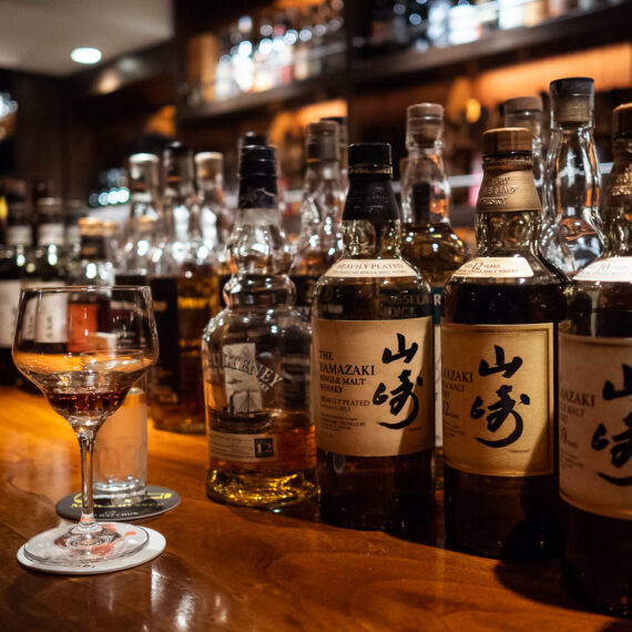 Japan travel photography: Bottles of whisky line the bar at Bar Leichardt, Fukuoka, Japan.