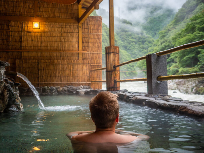 Japan travel photography: An open-air onsen (hot spring bath) at Hotel Iyaonsen, a hotel spa in Tokushima Prefecture, Shikoku, Japan.