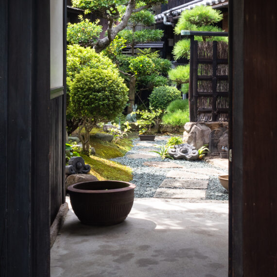 Japan travel photography: A Japanese garden seen through a doorway in Honmura district, Naoshima Island, Kagawa Prefecture, Japan.