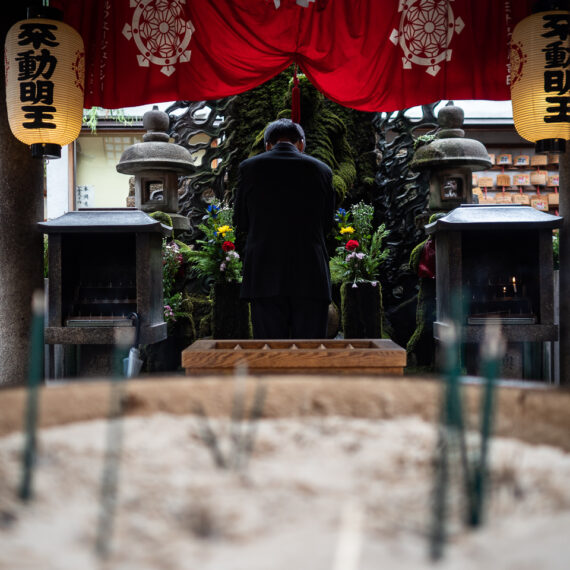 Japan travel photography: Hozen-ji, a buddhist temple in Dotonbori district, Osaka, Japan. The temple contains a moss-covered statue of the deity Fudo Myo-o, one of the Wisdom Kings of Vajrayana Buddhism.