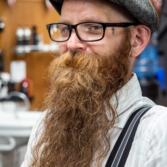 Portrait photography news and features: Mike Barby, a barber with Pall Mall Barbers near Trafalgar Square, London.