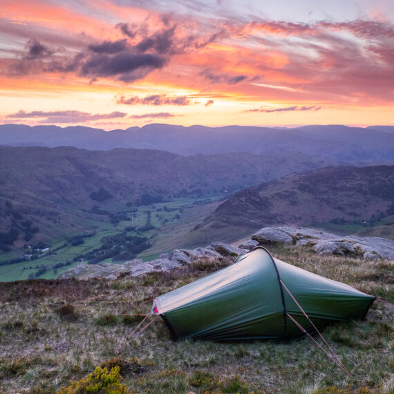Travel photography England: Sunrise over Great Langdale, seen from a wild camp on Pike o' Blisco, a fell in the Lake District, Cumbria, England.