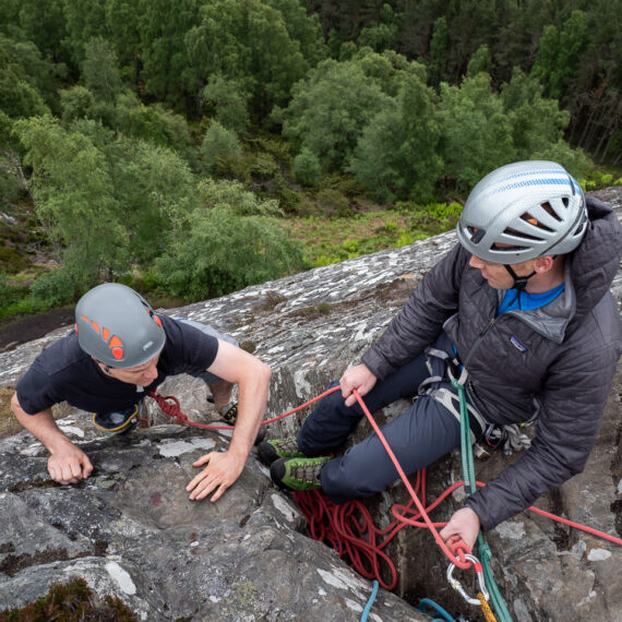 Adventure travel photography: Climbers at Kingussie Crag, Cairngorms National Park, Scotland, UK.