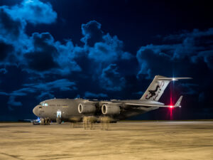 Humanitarian aid photography: UK military personnel prepare to board an RAF C-17 transport aircraft and Voyager passenger aicraft supporting humanitarian aid operations at Grantley Adams International Airport in Bridgetown, Barbados, on 8 September 2017.Royal Air Force logisticians from RAF Brize Norton have assisted with the delivery of military personnel and aid cargo to the Caribbean to support disaster relief in the wake of Hurricane IRMA. RAF aircraft - including C-17, A400M and Voyager aircraft - are supporting a joint task force of RAF, Royal Marines, Army and Royal Navy personnel who are supporting the Department for International Development as it delivers aid to stricken Caribbean islands.