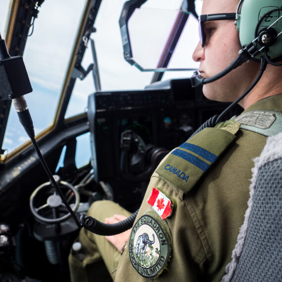 Humanitarian aid photography: Captain Kirk Belhumer of 436 Squadron Royal Canadian Air Force flies an RCAF CC-130J Hercules transport aircraft on a humanitarian aid mission in the Caribbean on 20 September 2017. The Canadian Armed Forces are supporting the UK's Department for International Development alongside more than 1,300 UK miltiary and civilian staff, delivering humanitarian aid and disaster relief to British Overseas Territories stricken by Hurricanes Irma and Maria. Canada has contributed two Hercules and one CP-140 Aurora maritime patrol aircraft to the operation, supporting a UK Royal Air Force Air Mobility fleet deployed with 38 Expeditionary Air Wing.