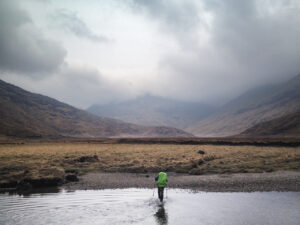 Coronavirus and hiking: Andy Wasley crosses the River Carnach in Knoydart, Scotland, during an attempt on the Cape Wrath Trail. (Image courtesy of Jan-Philipp Kappner.)