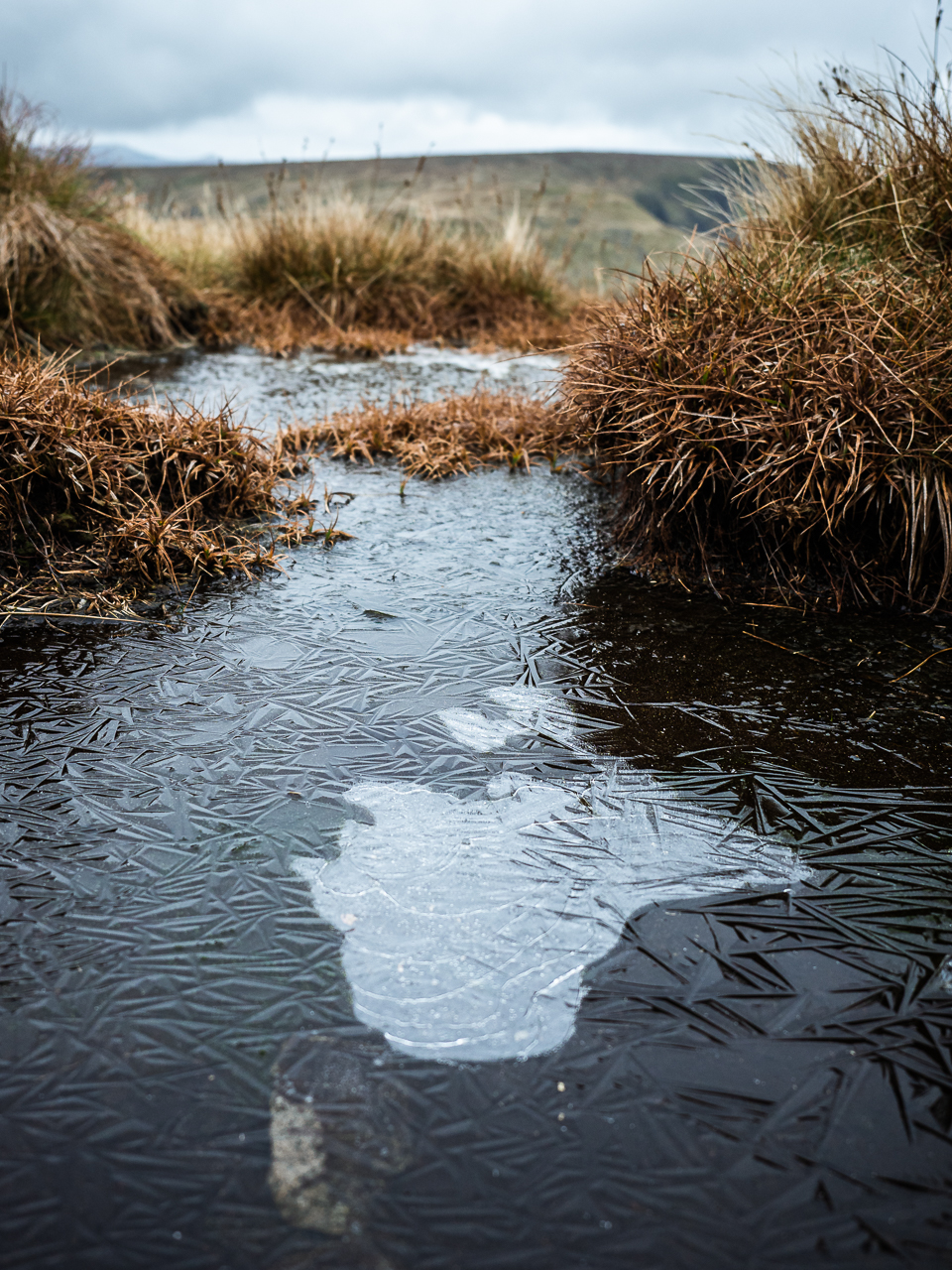 A frozen pond near Harter Fell, in the Lake District, Cumbria, England.