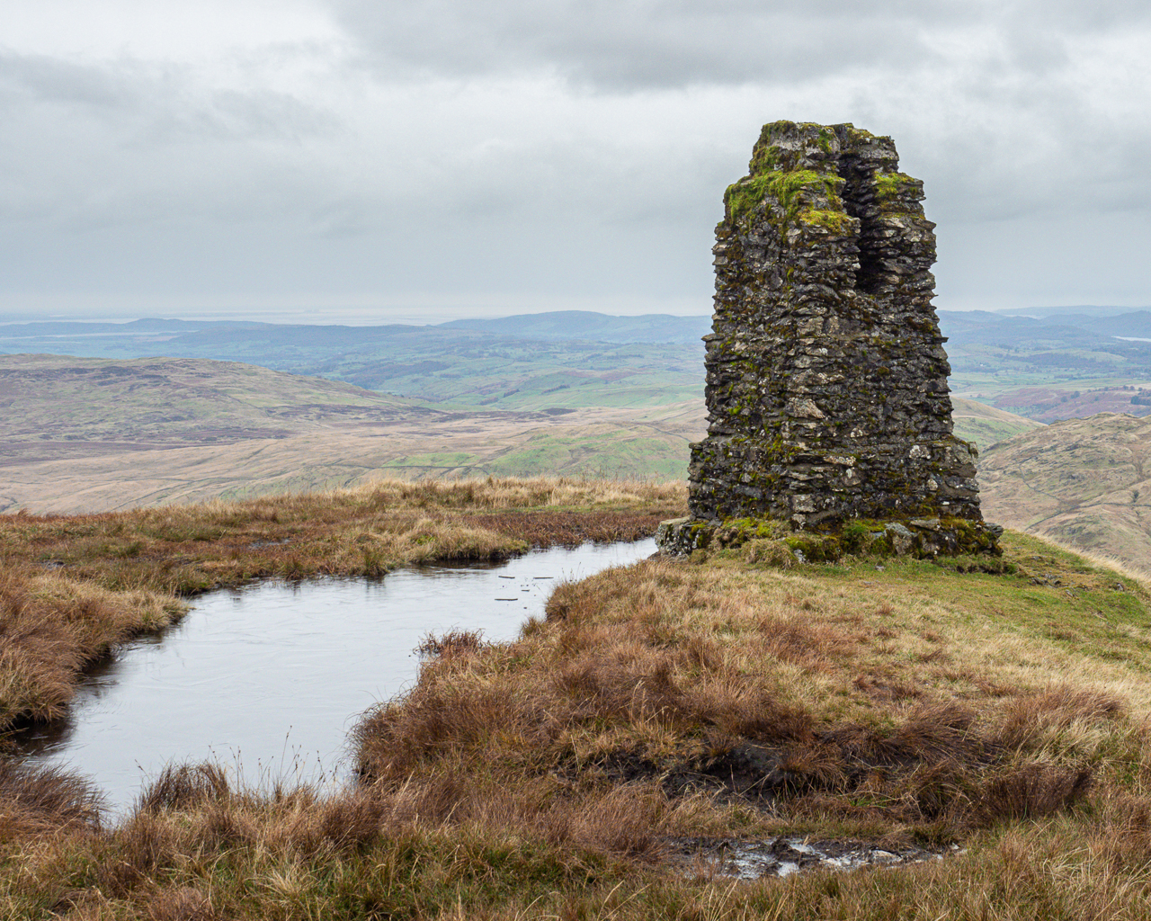 An abandoned survey pillar on Tarn Crag in the Lake District, Cumbria, England.