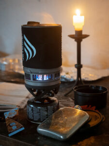 Mosedale Cottage: A Jetboil stove cooks food in Mosedale Cottage, a bothy in the Lake District, Cumbria, England.