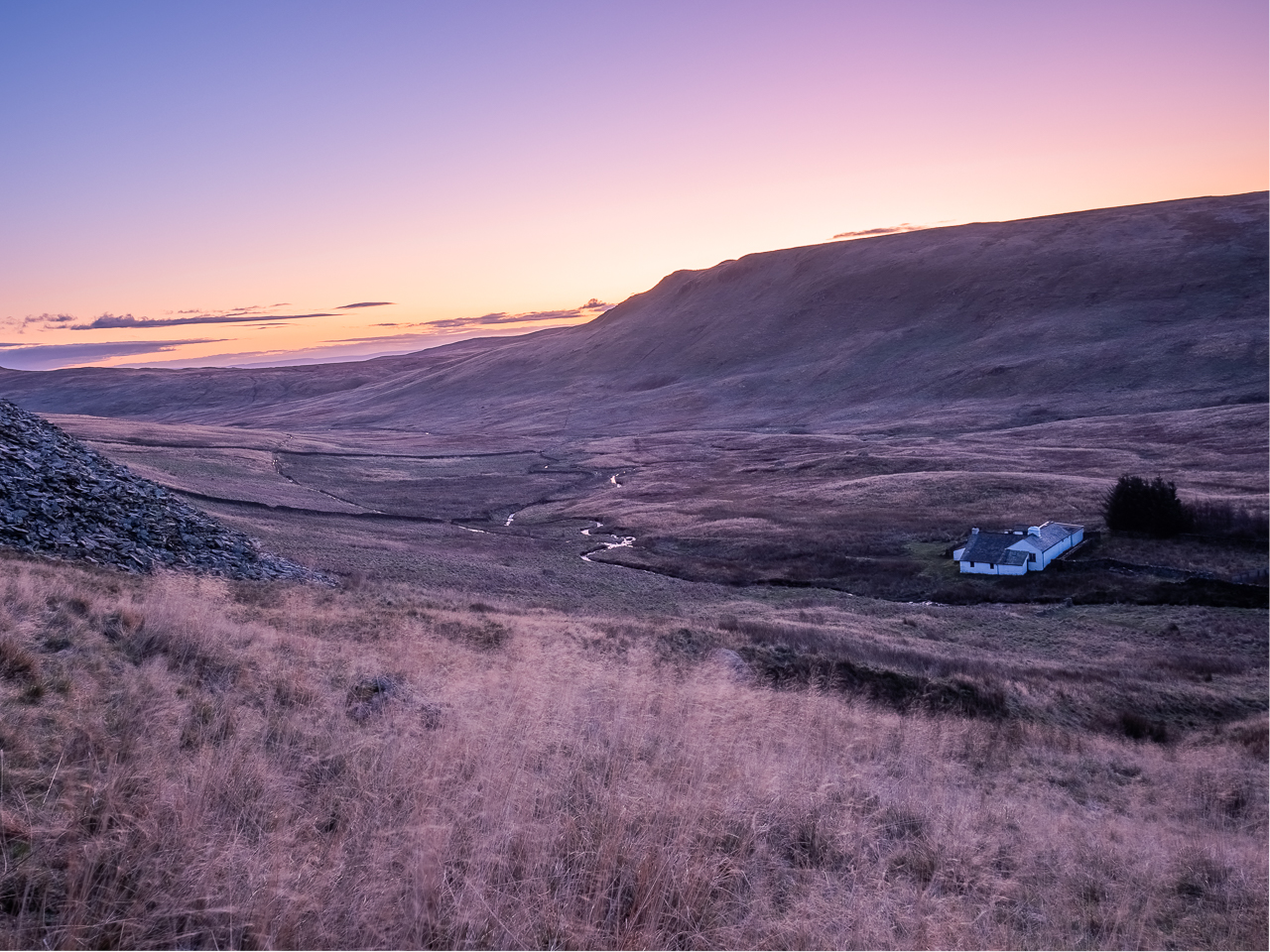Mosedale Cottage, a bothyt in the Lake District, Cumbria, England, seen at dawn from a nearby quarry.