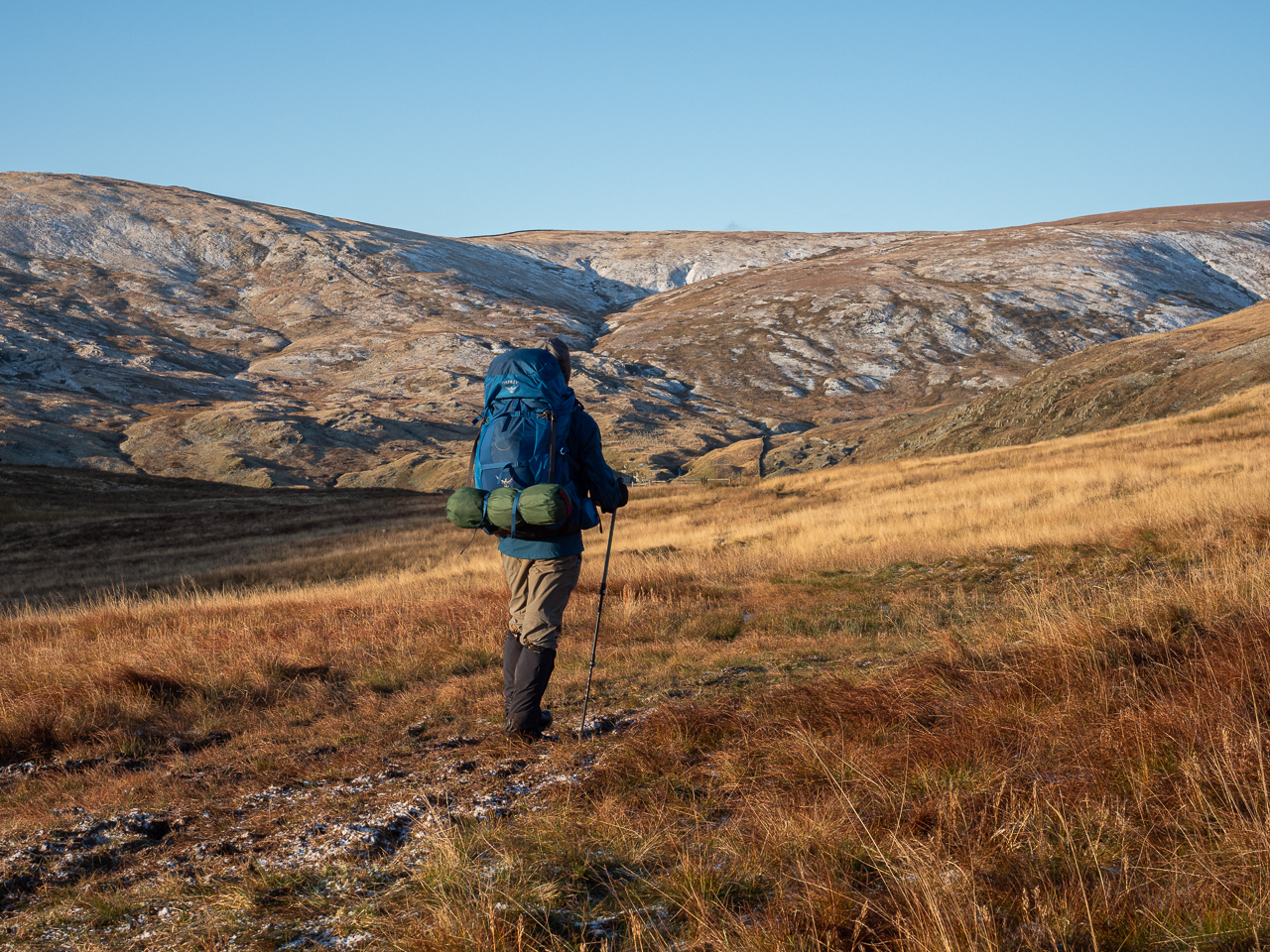 A hiker in the Shap Fells in the Lake District, Cumbria, England.